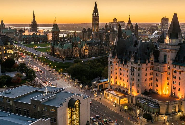 Ottawa from the air, looking north west along Wellington from Laurier bridge. Overlooking Parliament at sunset. Image courtesy of Ottawa Tourism.